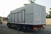 Special sound-attenuated container on trailer, for rental